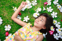 Little asian girl laying in green grass Stock Images