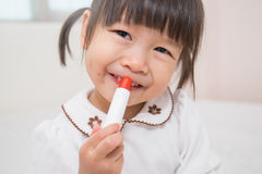 Little asian girl with lipstick Royalty Free Stock Image