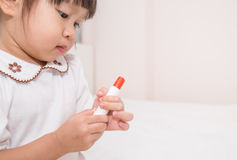 Little asian girl with lipstick Stock Images
