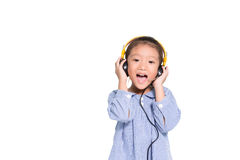 Little asian girl listen music and sing on isolate white backgro. Little asian girl listen music from headphone and sing on isolate white background Stock Images