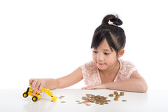 Little asian girl looking excavator toy Royalty Free Stock Photo