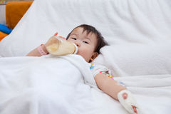 Little asian girl lying  on a medical bed Royalty Free Stock Images