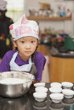 Little asian girl making cotton wool cake Stock Images