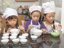 Little asian girl making cotton wool cake Stock Image