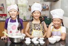 Little asian girl making cotton wool cake Royalty Free Stock Image
