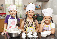 Little asian girl making cotton wool cake Stock Photo