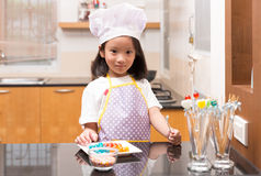 Little Asian girl making jelly candy Stock Photography