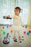 Little asian girl with microphone Stock Photography