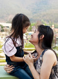 Little asian girl and mom. Stock Image