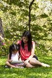 Little asian girl and mom in park. Stock Photos