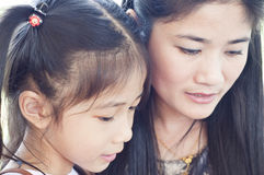 Little Asian girl and mom portrait. Stock Photography