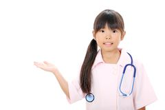 Little asian girl in a nurse uniform Royalty Free Stock Photo