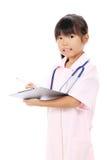 Little asian girl in a nurse uniform stock photography