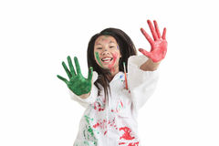 A little asian girl with paint on it isolate on Stock Photography
