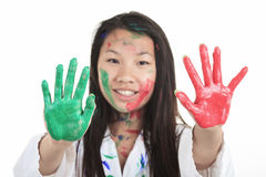 A little asian girl with paint on it isolate on Stock Images