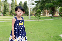 Little Asian girl in the park Royalty Free Stock Photography
