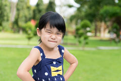 Little Asian girl in the park Royalty Free Stock Images