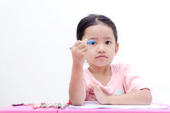 Little asian girl with pencil color on white background Stock Photo