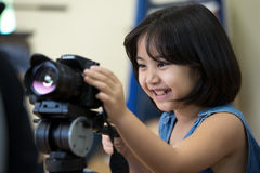 Little Asian girl photographer Royalty Free Stock Photo