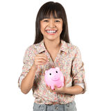Little asian girl with piggy bank Royalty Free Stock Images