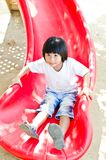 Little Asian girl play in playgound Royalty Free Stock Image