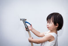 Little asian girl play with water hose Royalty Free Stock Image