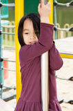 Little Asian girl on the playground Stock Photo
