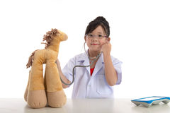 Little asian girl playing a doctor Stock Photos