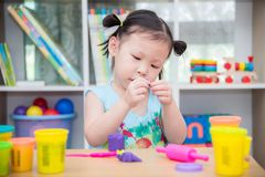 Girl playing dough at school Stock Photo