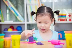 Girl playing dough at school Royalty Free Stock Photos