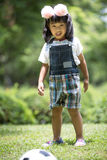 Little asian girl playing football at the park Stock Images