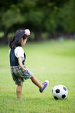 Little asian girl playing football at the park Royalty Free Stock Photo