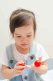 Little asian girl playing Royalty Free Stock Image