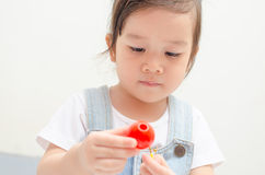 Little asian girl playing Stock Photo