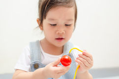 Little asian girl playing Stock Images