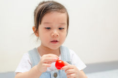 Little asian girl playing Stock Photos