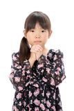 Little asian girl praying. Portrait of little asian girl praying on white background Royalty Free Stock Image