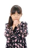 Little asian girl praying. Portrait of little asian girl praying against a white background Stock Images