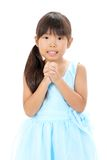 Little asian girl praying. Studio photo of little asian girl praying against a white background Stock Photo