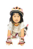 Little asian girl in protective gear fell off while rollerskatin Stock Images