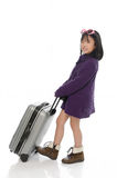 Little asian girl pulling heavy baggage Stock Photography