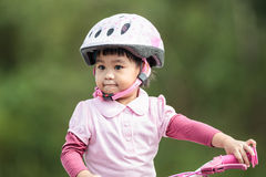 Little asian girl ride the bicycle Royalty Free Stock Images