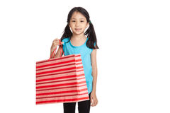 Little asian girl with shopping bag Royalty Free Stock Images