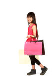 Little asian girl with shopping bags Royalty Free Stock Photos