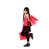 Little asian girl with shopping bags Royalty Free Stock Image