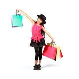 Little asian girl with shopping bags Royalty Free Stock Images