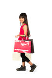 Little asian girl with shopping bags Royalty Free Stock Photography