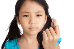 Little asian girl show finger with bandage focus at bandage Royalty Free Stock Photos