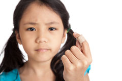 Little asian girl show finger with bandage Royalty Free Stock Photos