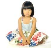 Little asian girl sitting on the floor Royalty Free Stock Photos